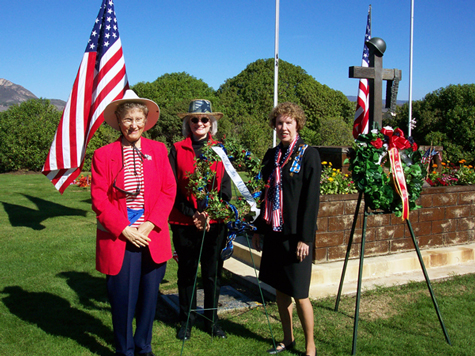 Laying a wreath at the tomb of the Unknown Soldier, Los Osos Valley Memorial Park are Mary Bhuta, Junia Wolf and Thelma Hayes, Regent on 11 November 2002